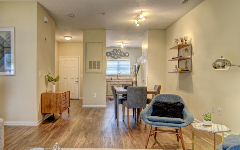 bright and spacious model living room with fireplace and access to private patio